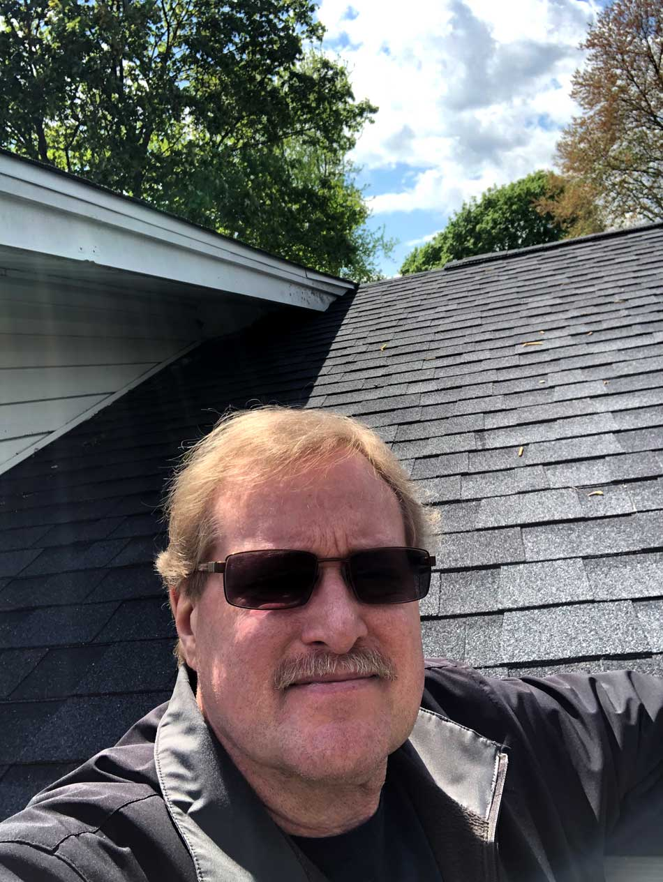 Certified Home Inspector Vern Eldridge on a Roof